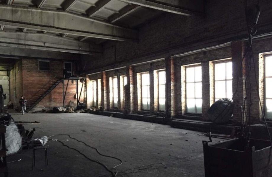 Производственная площадка в собственность  со зданием.